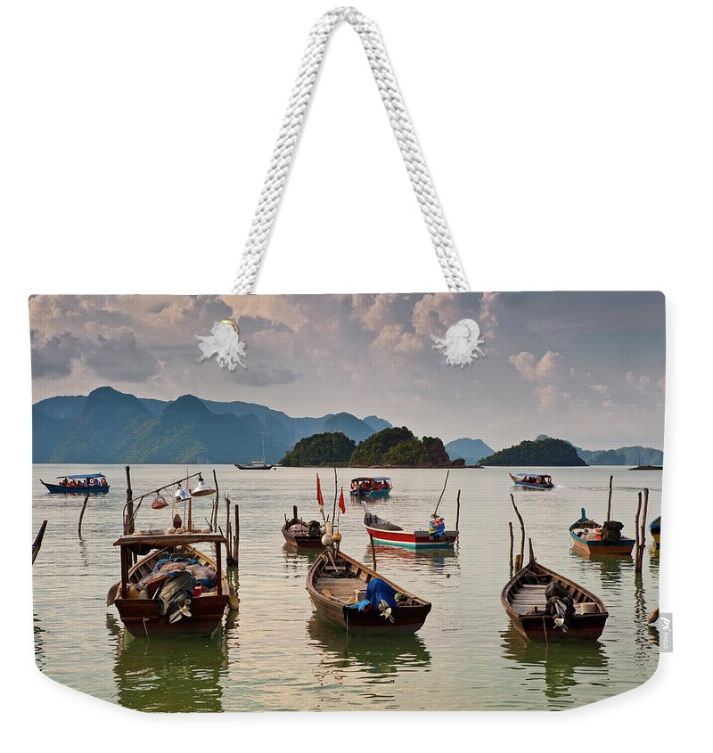 Southeast Asia Weekender Tote Bag featuring the photograph Boats Moored In Sea, Teluk Baru by Richard I'anson