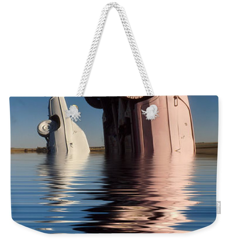 Cadillac Weekender Tote Bag featuring the photograph Bobbing For Carburetors by Jerry McElroy