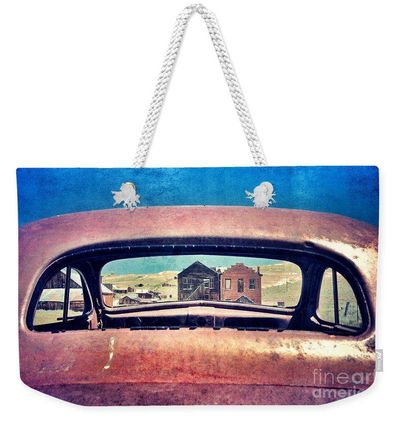 Car Weekender Tote Bag featuring the photograph Bodie Through Car Window by Jill Battaglia