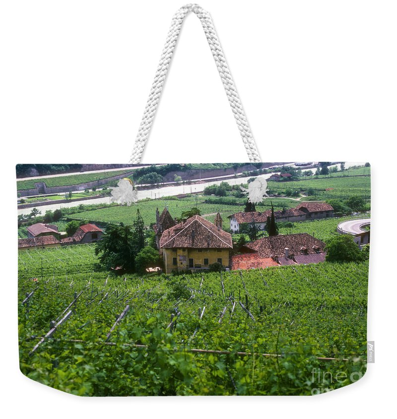 Bolzano Vineyard Vineyards Grape Vine Vines Isarco River Rivers Stream Streams Water Structure Structures Buildings Buildings Tree Trees Landscape Landscapes Italy Weekender Tote Bag featuring the photograph Bolzano Vineyard by Bob Phillips