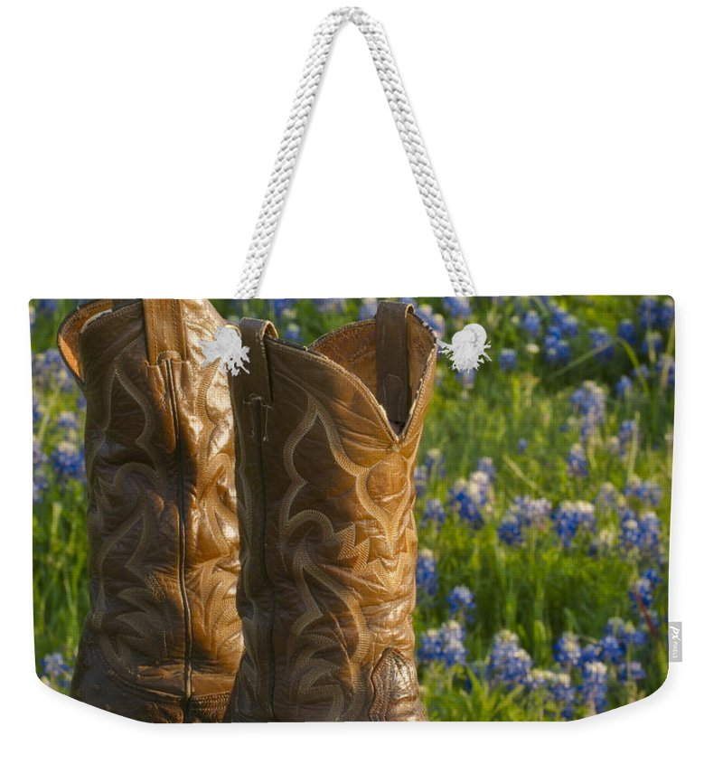 Bluebonnet Weekender Tote Bag featuring the photograph Boots And Bluebonnets by David and Carol Kelly