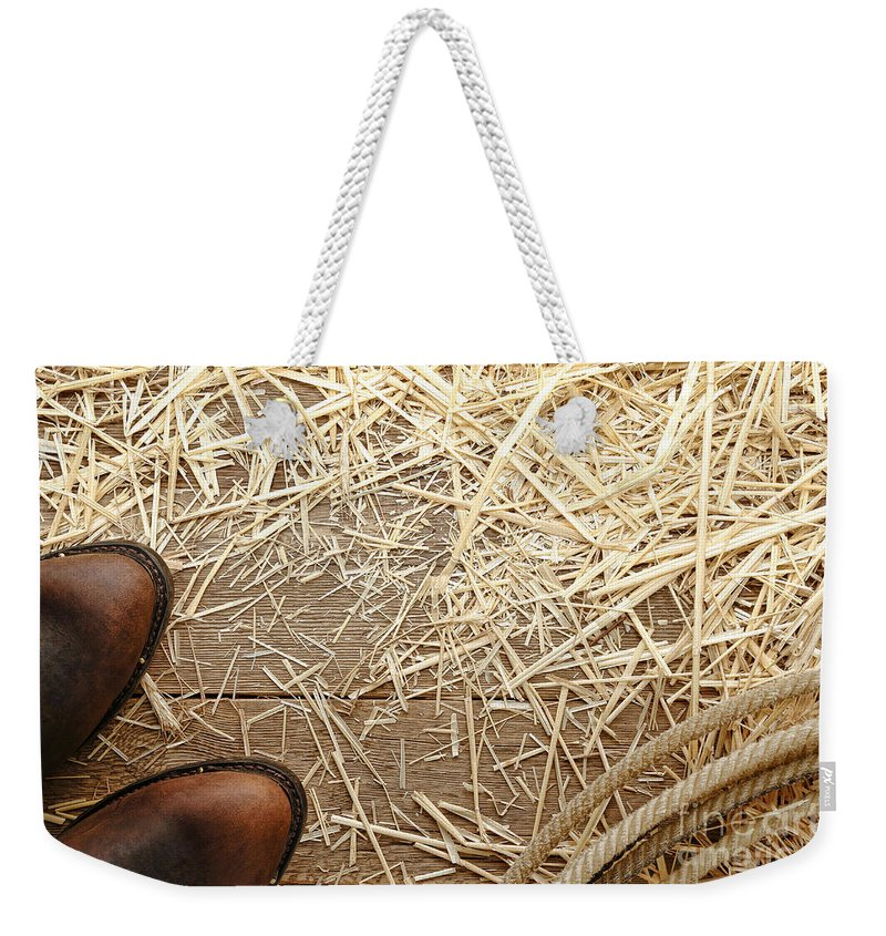 Cowboy Weekender Tote Bag featuring the photograph Boots On Wood by Olivier Le Queinec