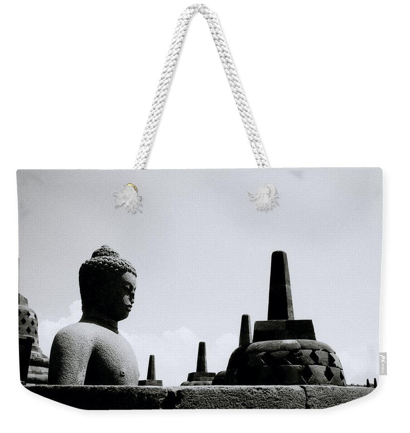 Borobudur Weekender Tote Bag featuring the photograph The Contemplation Of The Buddha by Shaun Higson