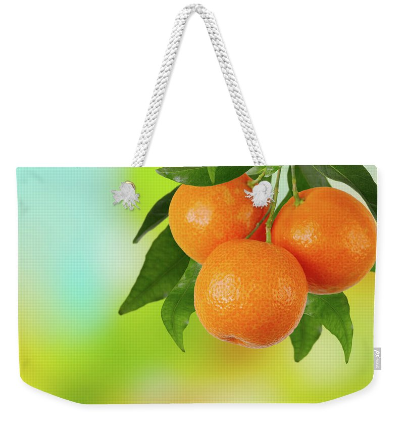 Hanging Weekender Tote Bag featuring the photograph Branch Of Tangerines by Sashahaltam