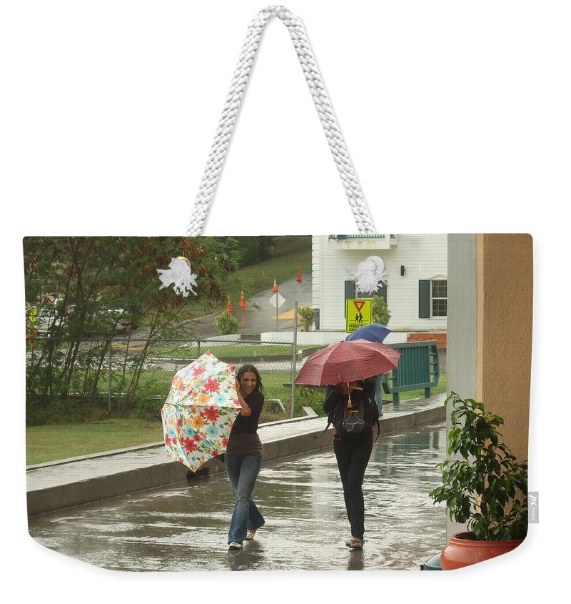 Weekender Tote Bag featuring the photograph Braving The Rain by Katerina Naumenko
