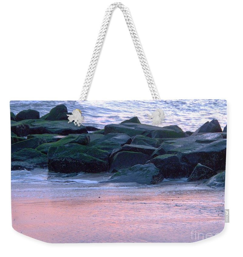 Breakwater Weekender Tote Bag featuring the photograph Breakwater Rocks At Sunset Beach Cape May by Eric Schiabor