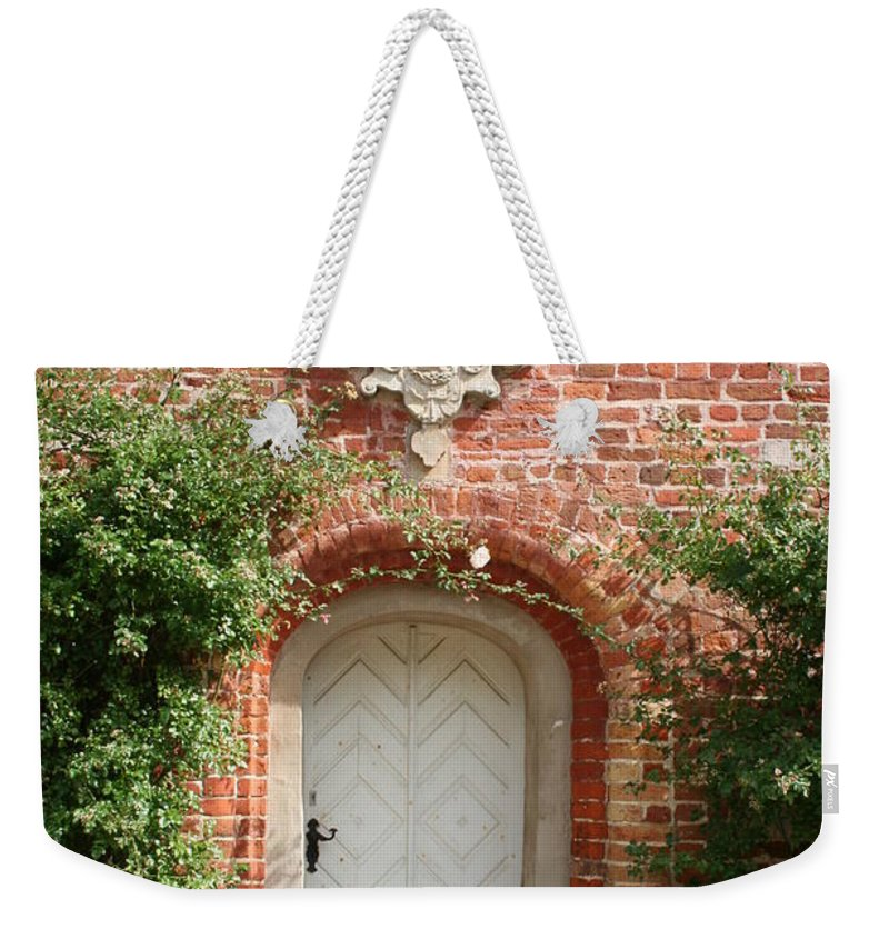 Brick Weekender Tote Bag featuring the photograph Brickcastle And White Door by Christiane Schulze Art And Photography