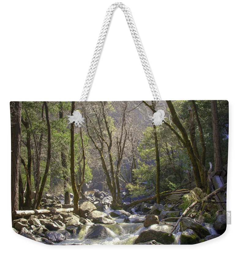 With It's Glorious Mist In The Background Weekender Tote Bag featuring the photograph Bridalveil Falls Feeds A Marvelous Stream by Jon Zich