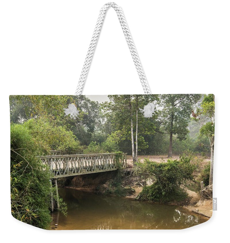 Tranquility Weekender Tote Bag featuring the photograph Bridge Over Siem Reap River On The Road by Cultura Exclusive/gary Latham