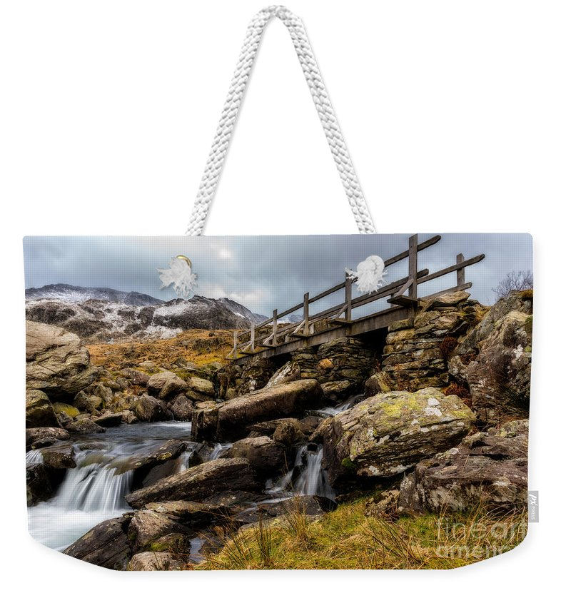 Waterfall Weekender Tote Bag featuring the photograph Bridge To Idwal by Adrian Evans