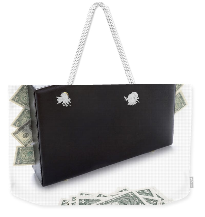 Money Weekender Tote Bag featuring the photograph Briefcase Stuffed With Dollar Bills by Lee Avison