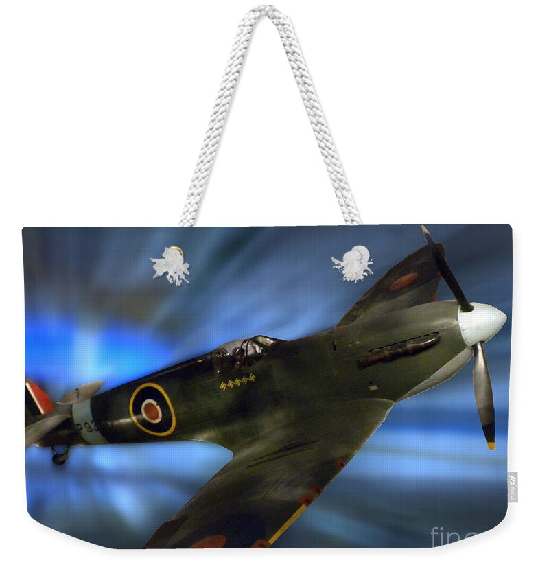 Transportation Weekender Tote Bag featuring the photograph British Ww II Fighter Plane by Thomas Woolworth