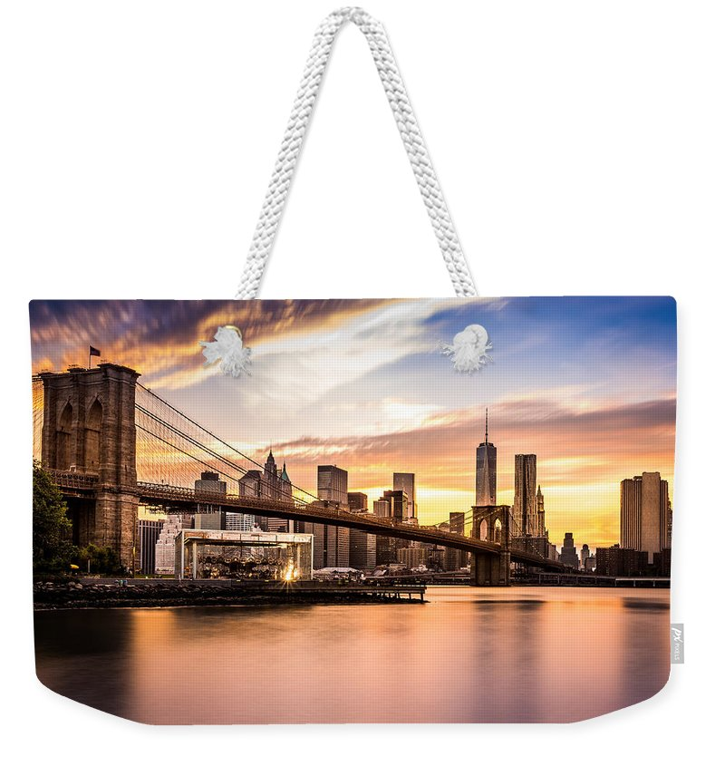 America Weekender Tote Bag featuring the photograph Brooklyn Bridge At Sunset by Mihai Andritoiu
