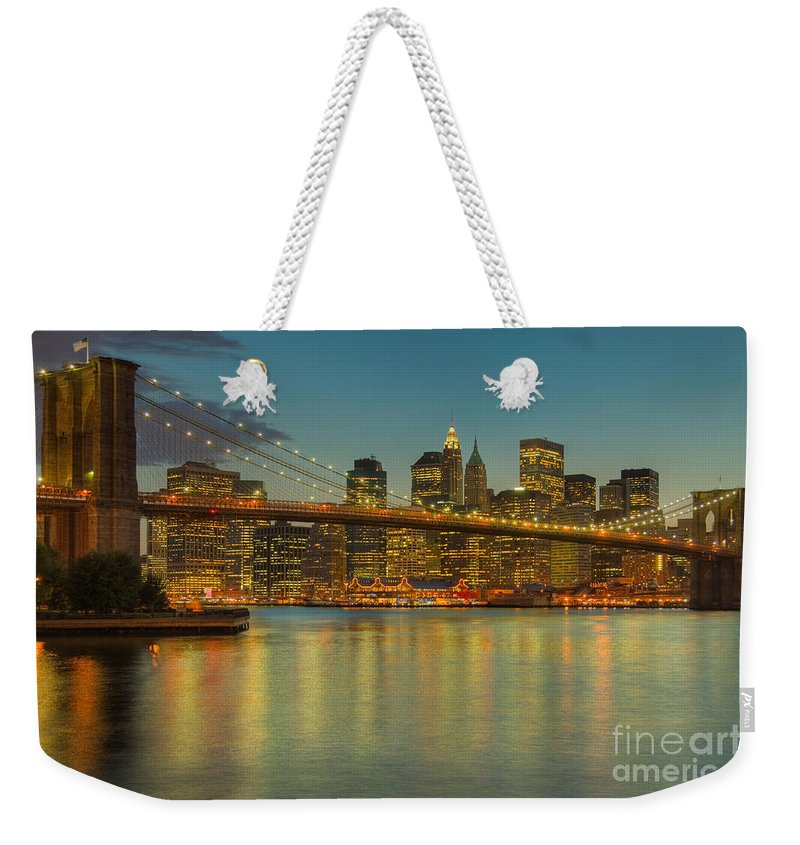 Clarence Holmes Weekender Tote Bag featuring the photograph Brooklyn Bridge Twilight by Clarence Holmes