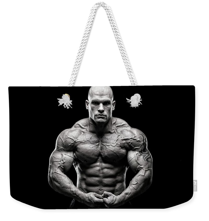 Toughness Weekender Tote Bag featuring the photograph Brutal Power by Vuk8691