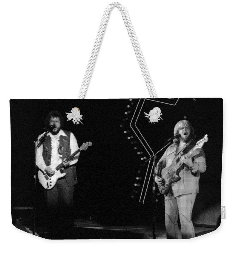 Bachman-turner Overdrive Weekender Tote Bag featuring the photograph Bto In Spokane In 1976 by Ben Upham