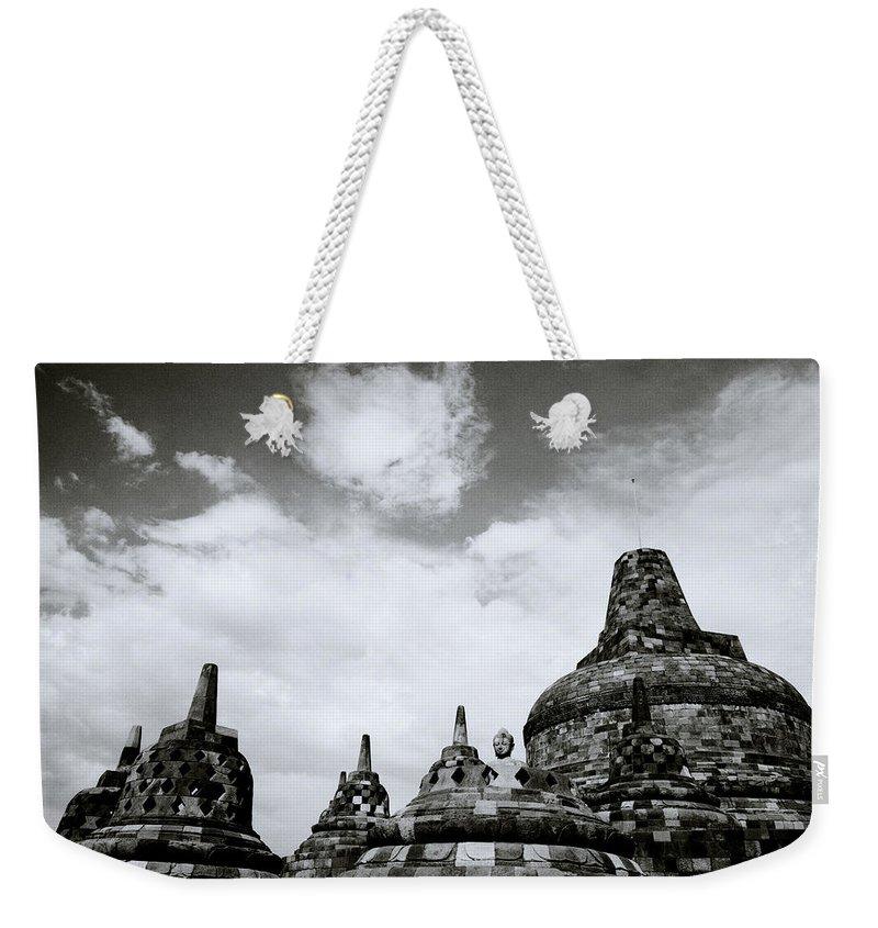 Borobudur Weekender Tote Bag featuring the photograph Buddha And Stupas by Shaun Higson