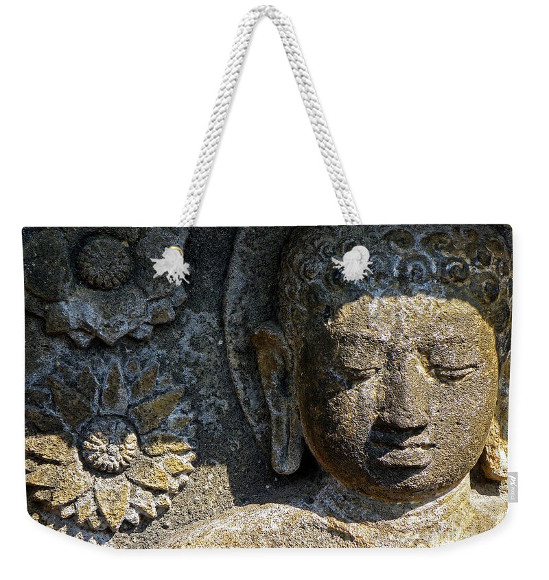 Buddha Buddhist Indonesia Nirvana Java Borubador Stone Sculpture Relief chiaro Scuro Temple Rock Portrait Faces Courtiers Dhamma Damma Temple bass Relief Enlightened Enlightenment Asia Religion Faith Impermanence volcanic Rock Weekender Tote Bag featuring the photograph Buddha At Borubador 1 by Neil Pollick