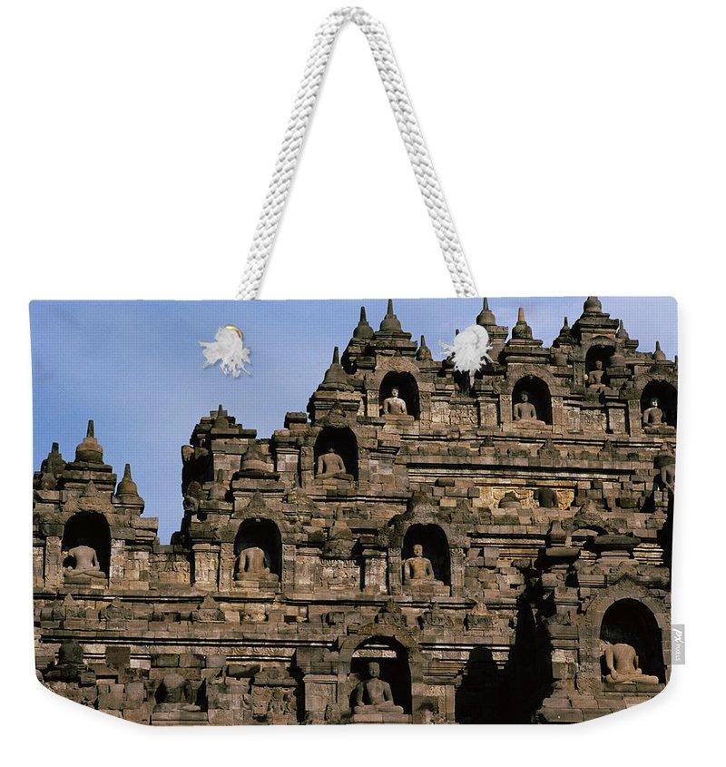 Borobudur Weekender Tote Bag featuring the photograph Buddhas Of Borobudur by Shaun Higson