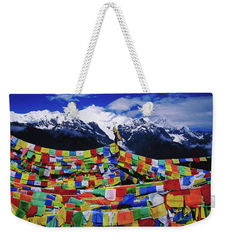 Chinese Culture Weekender Tote Bag featuring the photograph Buddhist Prayer Flags With Meili by Richard I'anson