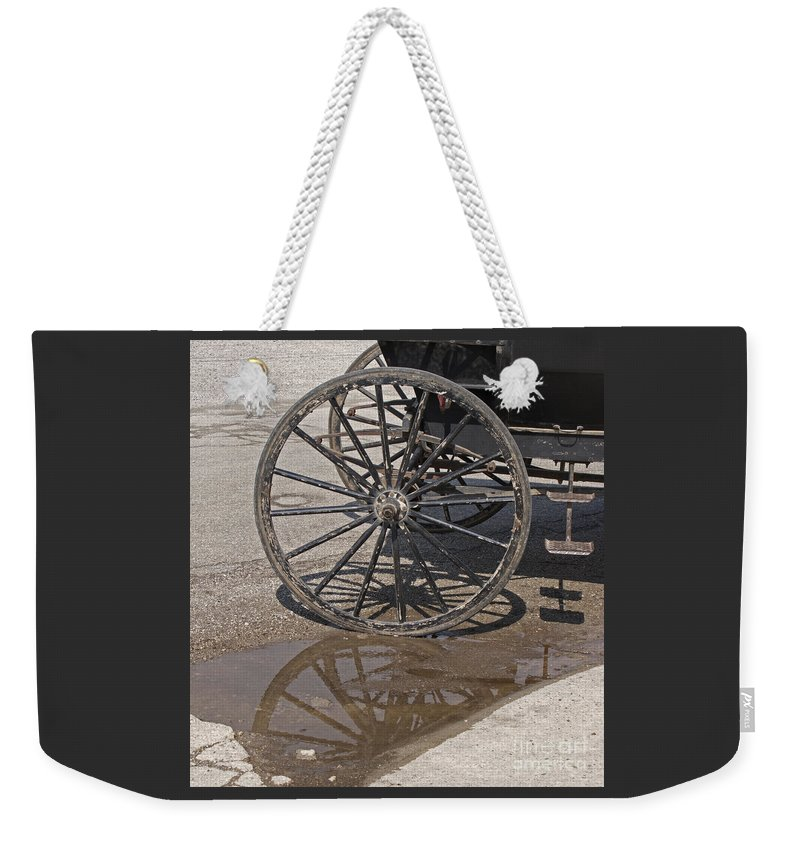 Amish Weekender Tote Bag featuring the photograph Buggy Wheels by Ann Horn