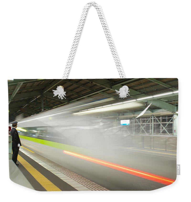 Shinkansen Weekender Tote Bag featuring the photograph Bullet Train by Sebastian Musial