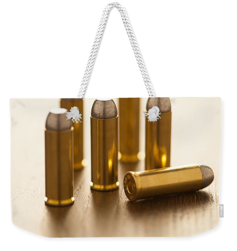 Weapon Weekender Tote Bag featuring the photograph Bullets by Lee Avison