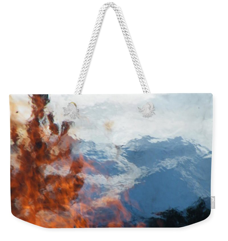 Burning Weekender Tote Bag featuring the photograph Burning The Winter Blues Away by Brian Boyle