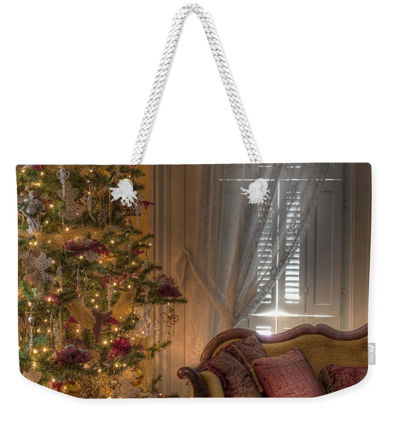 Inside; Indoors; Interior; Sofa; Christmas; Tree; Window; Curtains; Drapes; Presents; Gift; Wood; Rug; Victorian; Decorations; Ornaments; Lights; Seasonal; Season; Holiday Weekender Tote Bag featuring the photograph By The Christmas Tree by Margie Hurwich
