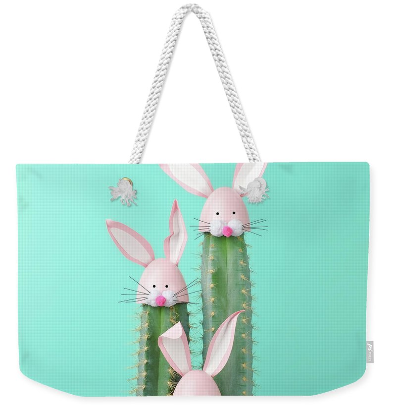 Easter Bunny Weekender Tote Bag featuring the photograph Cactus With Easter Rabbit Decorations by Juj Winn