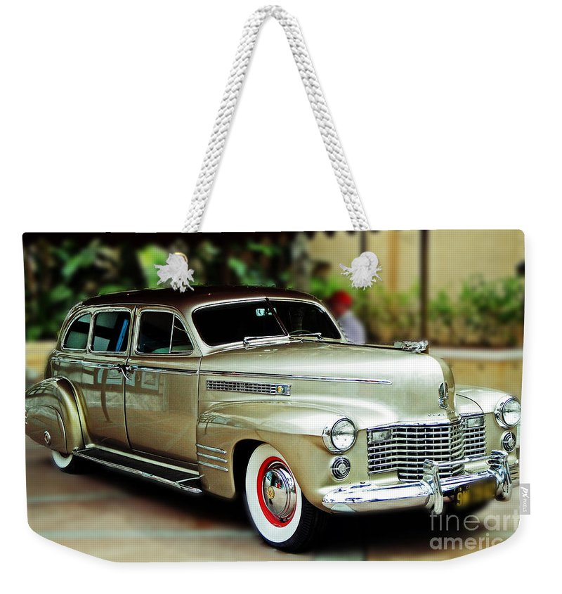 Cadillac Weekender Tote Bag featuring the photograph Caddy 2 by Kevin Fortier