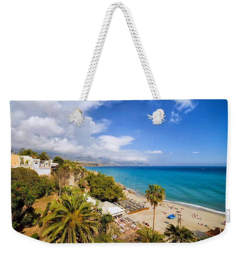Costa Weekender Tote Bag featuring the photograph Calahonda Beach In Nerja by Artur Bogacki