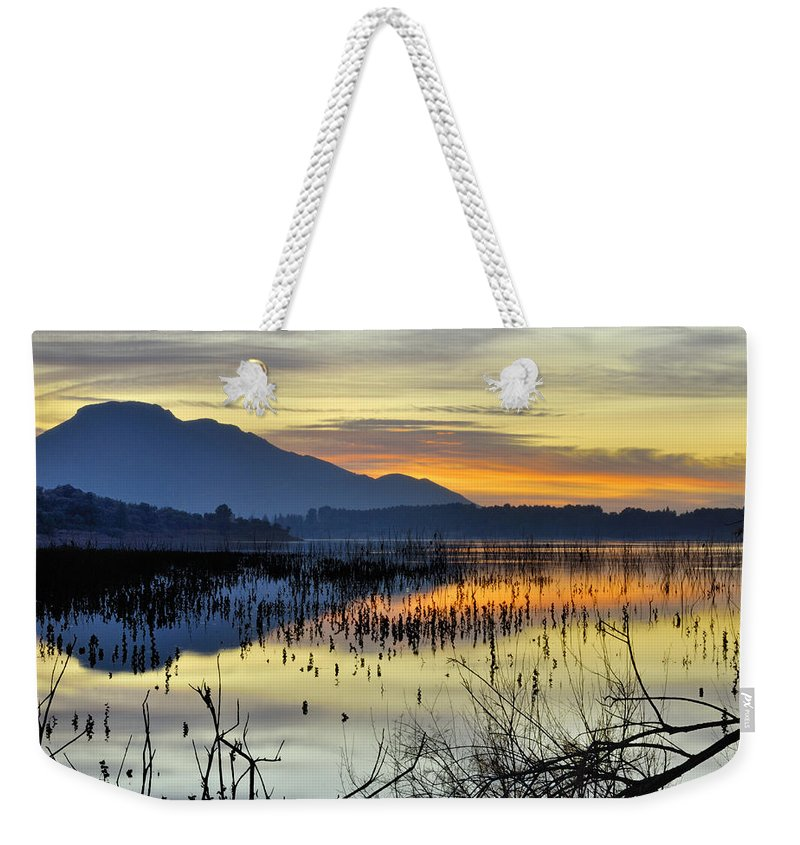Sunrise Weekender Tote Bag featuring the photograph Calm At The Lake by Guido Montanes Castillo