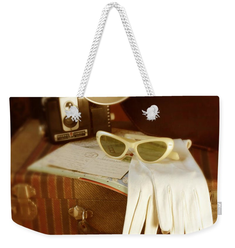 Sunglasses Weekender Tote Bag featuring the photograph Camera Sunglasses On Luggage by Jill Battaglia