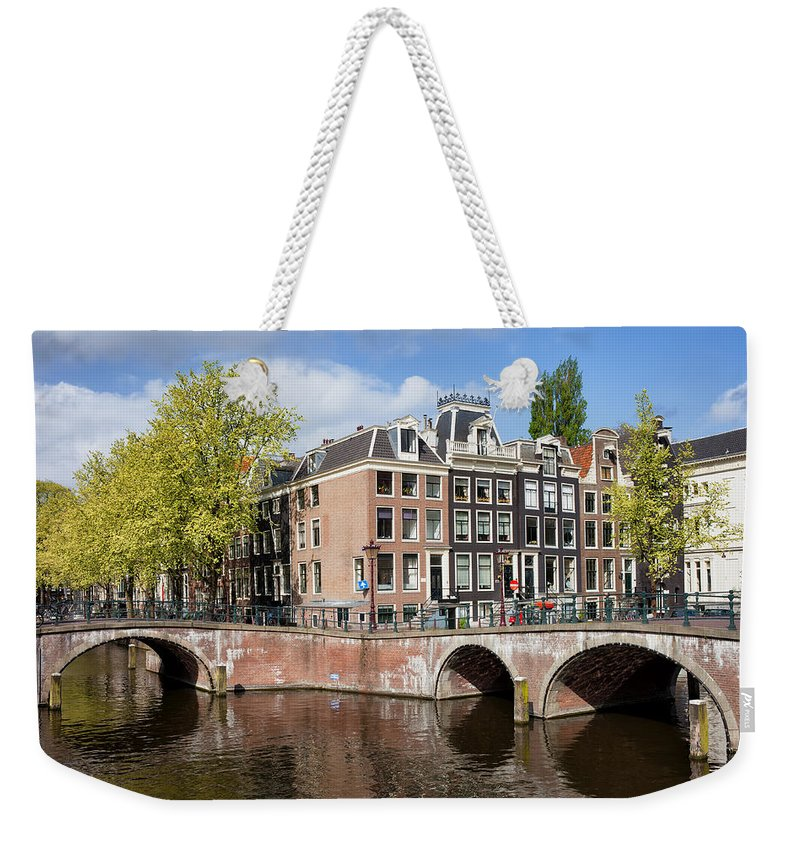 Amsterdam Weekender Tote Bag featuring the photograph Canal Houses In Amsterdam by Artur Bogacki