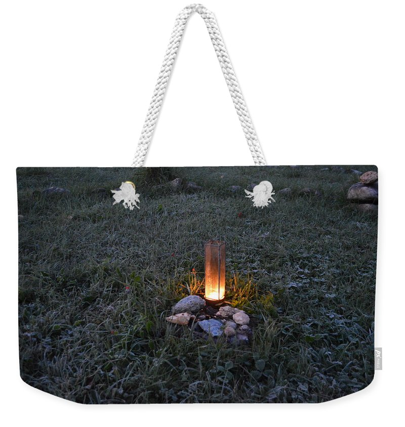 Candle Weekender Tote Bag featuring the photograph Candle Glow by Thomas Phillips