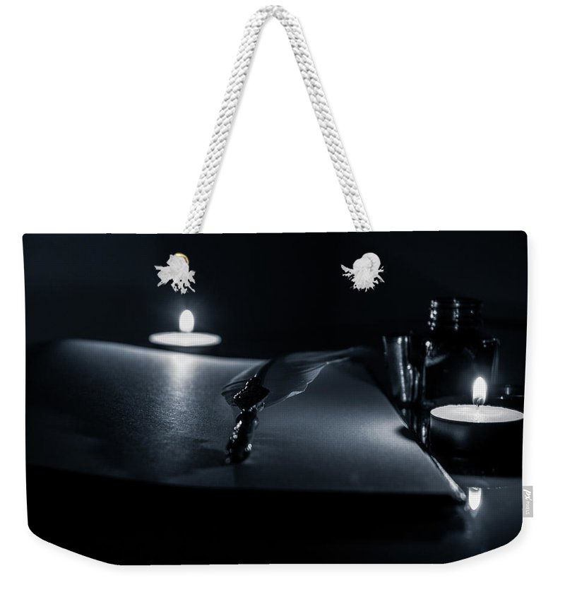 Pen Weekender Tote Bag featuring the photograph Candlelight by Andrea Mazzocchetti