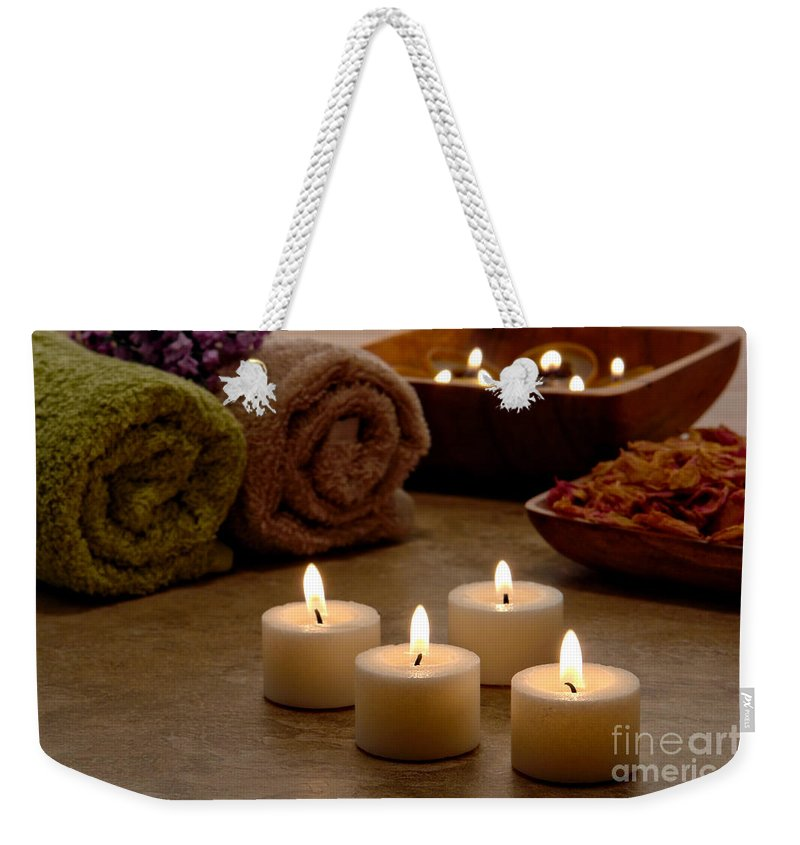 Spa Weekender Tote Bag featuring the photograph Candles In A Spa by Olivier Le Queinec