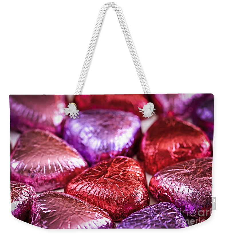 Candy Weekender Tote Bag featuring the photograph Candy Hearts by Elena Elisseeva