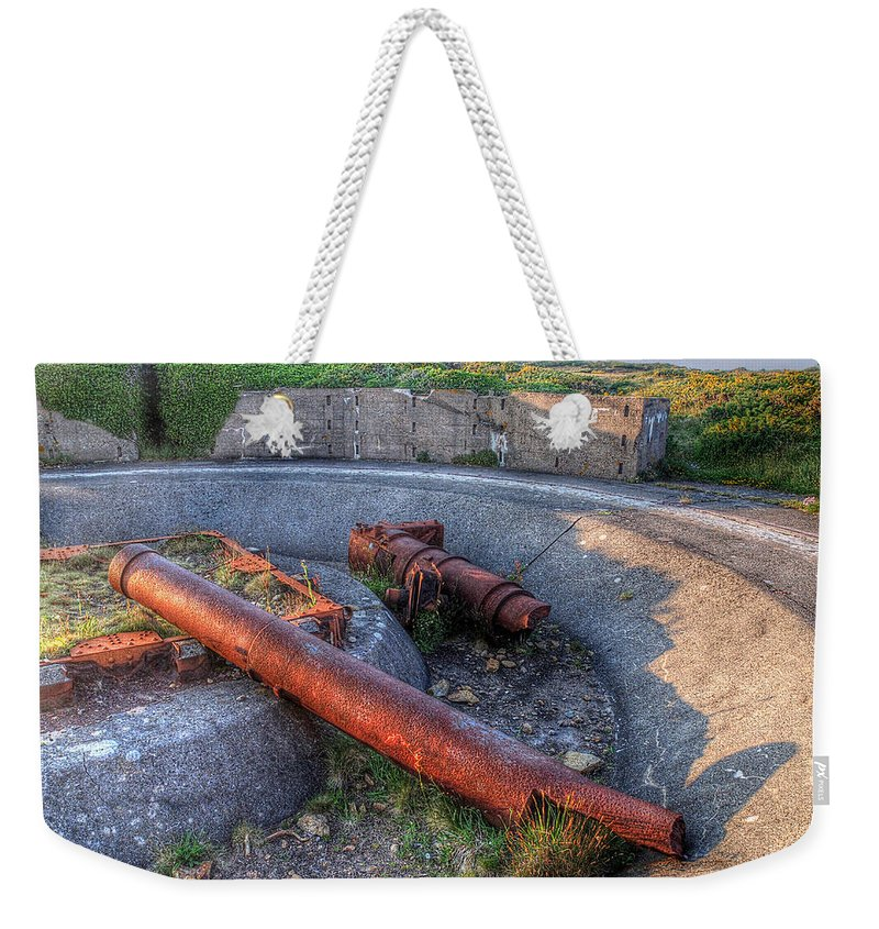 Cannon Weekender Tote Bag featuring the photograph Cannon Remains From Ww2 by Gill Billington