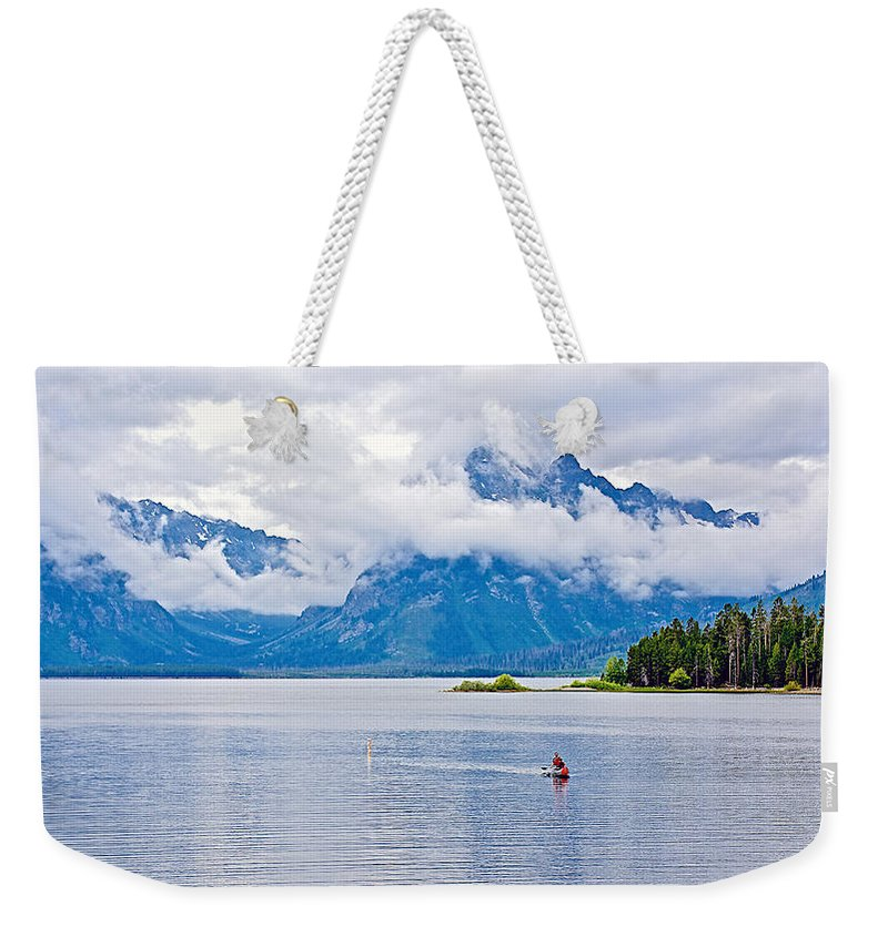 Canoeing In Colter Bay In Grand Teton National Park Weekender Tote Bag featuring the photograph Canoeing In Colter Bay In Grand Teton National Park-wyoming by Ruth Hager