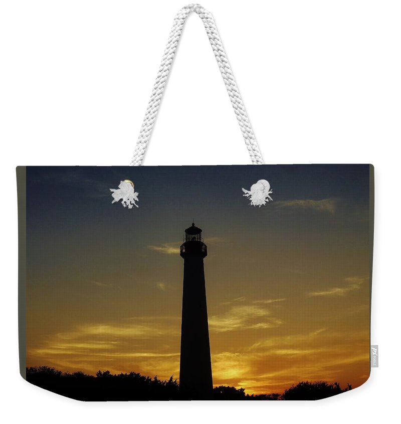 Lighthouse Weekender Tote Bag featuring the photograph Cape May Lighthouse At Sunset by Ed Sweeney