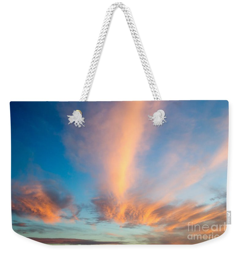 Orange Sunset Weekender Tote Bag featuring the photograph Captivating Clouds by Alanna DPhoto