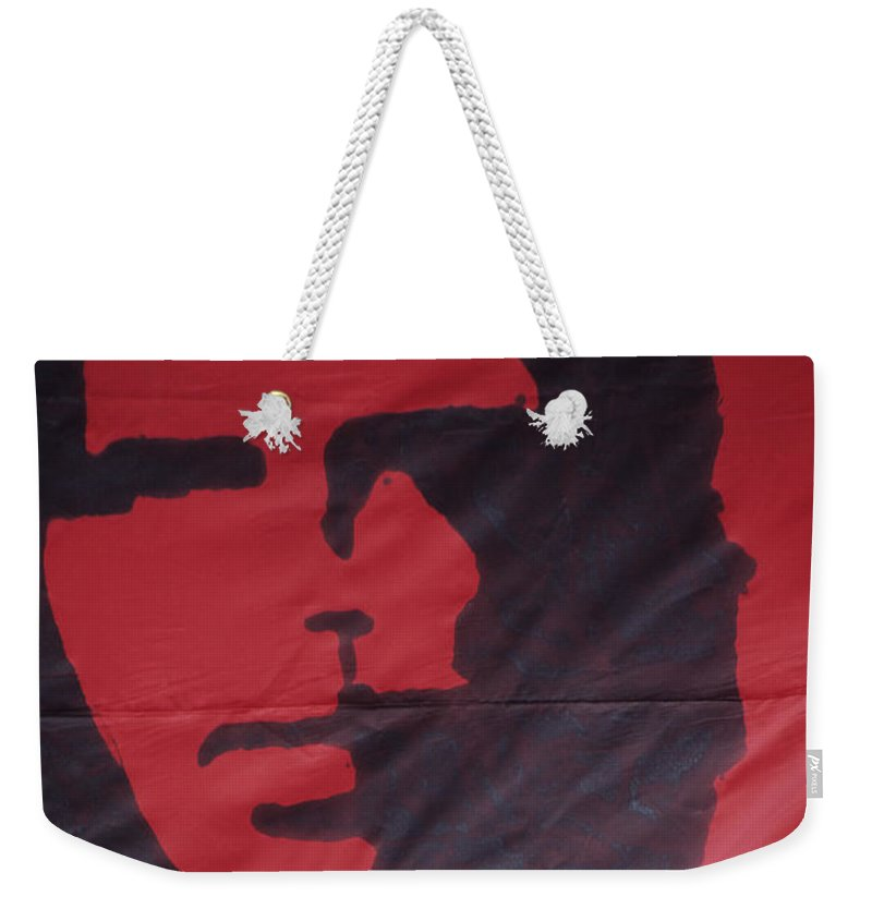 Che Guevara Weekender Tote Bag featuring the photograph Caring Che by James Brunker