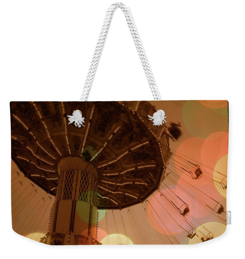 Carnival Weekender Tote Bag featuring the photograph Carnival Circles Go Round by Gothicrow Images