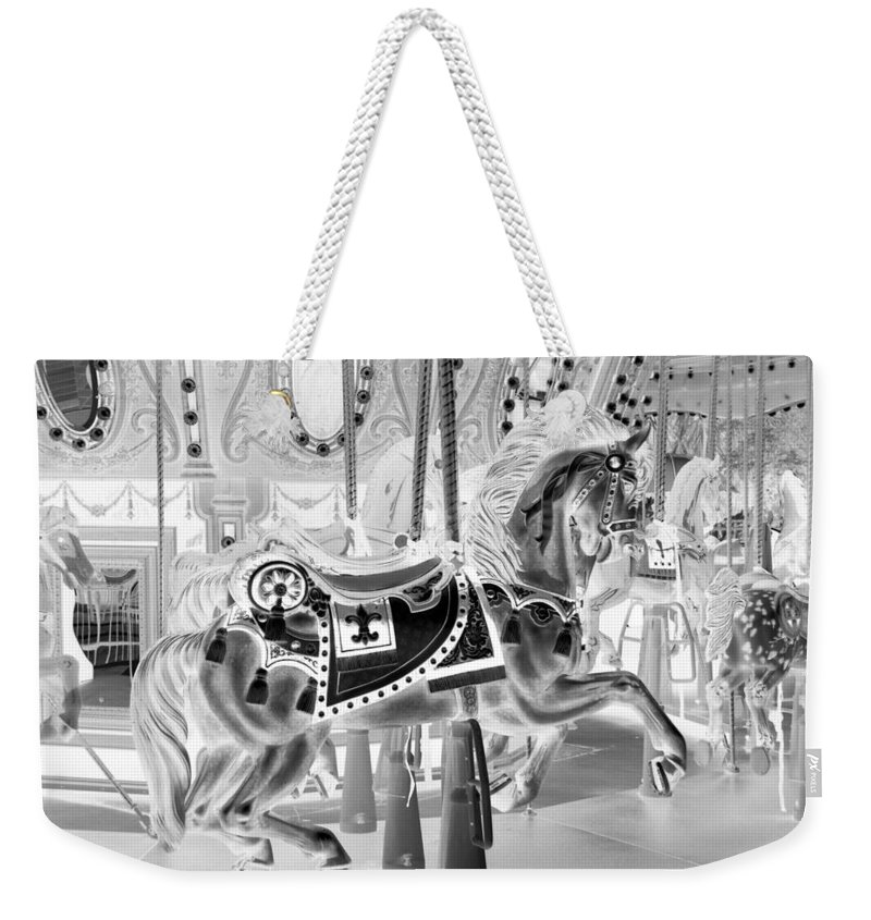 Carousel Weekender Tote Bag featuring the photograph Carousel In Negative 3 by Rob Hans