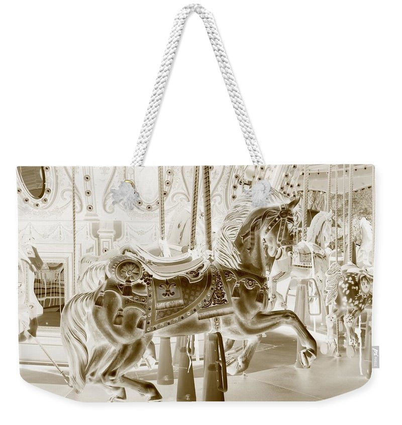 Carousel Weekender Tote Bag featuring the photograph Carousel In Negative Sepia by Rob Hans