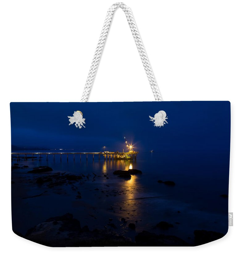 Carpinteria Weekender Tote Bag featuring the photograph Carpinteria Blue And Gold by John Daly