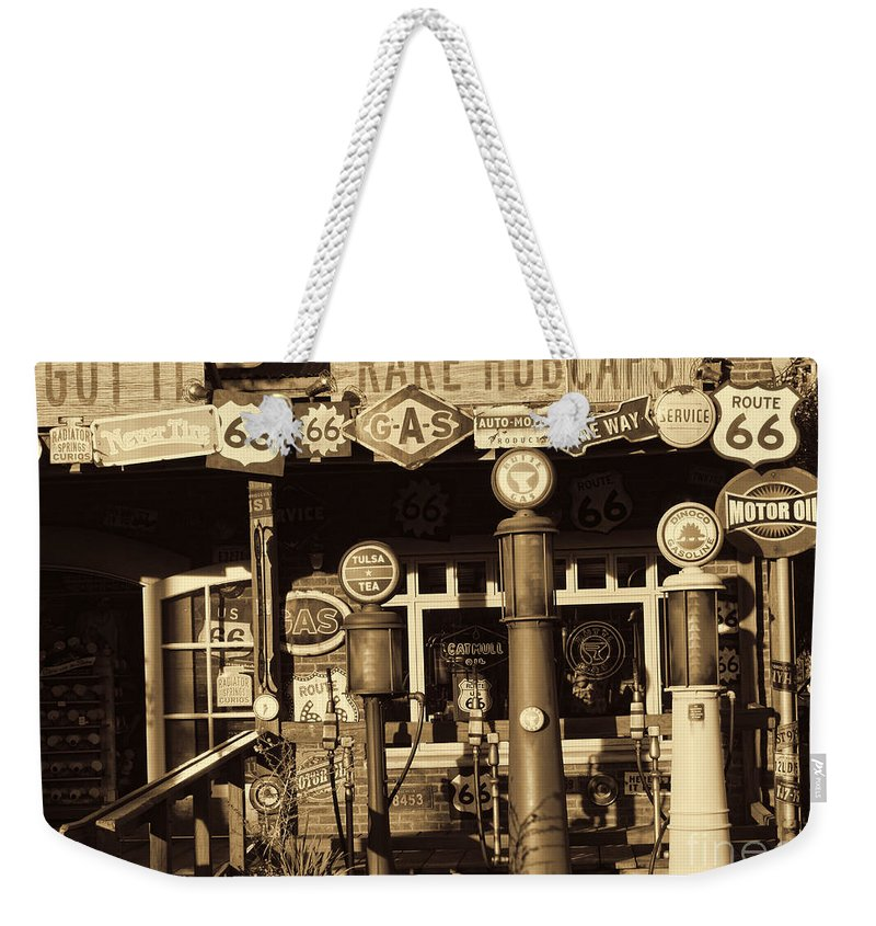 Disney California Adventure Weekender Tote Bag featuring the photograph Carsland Route 66 by Tommy Anderson
