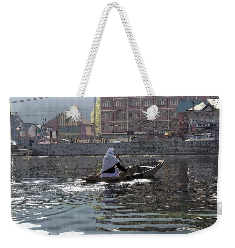 Action Weekender Tote Bag featuring the photograph Cartoon - Light Following This Lady On A Wooden Boat On The Dal Lake In Srinagar by Ashish Agarwal